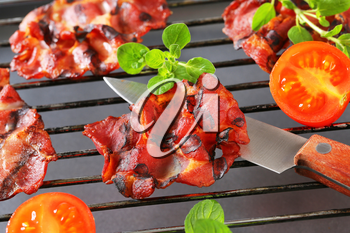 Crispy bacon on barbecue grill
