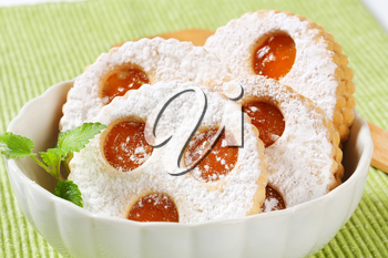 Linzer cookies dusted with confectioner's sugar