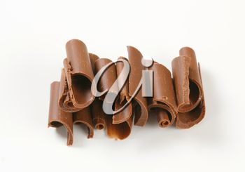 Chocolate curls on white background