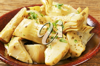 Artichoke hearts dressed in oil and herb marinade