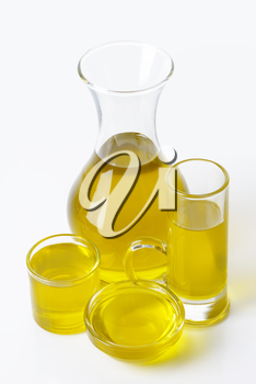 Olive oil in clear glass serving vessels