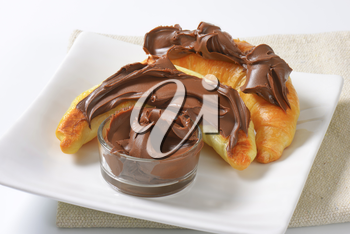 croissants topped with chocolate butter spread