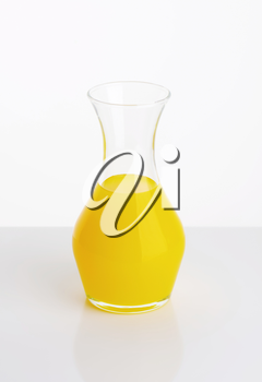 Yellow fresh fruit juice in a carafe