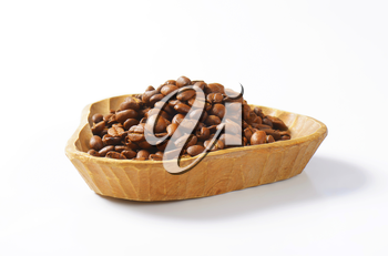 bowl of coffee beans on white background