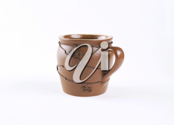 handcrafted pottery mug decorated with wire