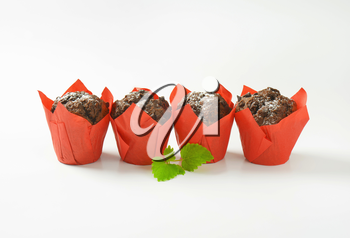Double chocolate cupcakes wrapped in red paper