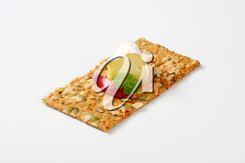 pumpkin seed cracker with white rind cheese