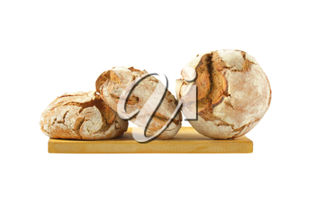 three round loaves of bread on wooden cutting board