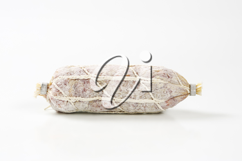 French dry cured sausage on white background