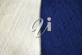contrasting abstract background of blue and white color in the form of woolen threads for knitting