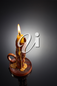 candlestick with candle on black background
