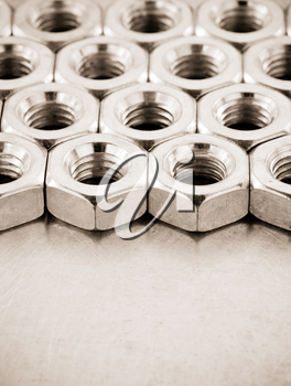 nuts tool at metal background texture