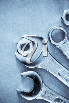 wrench tools at metal background