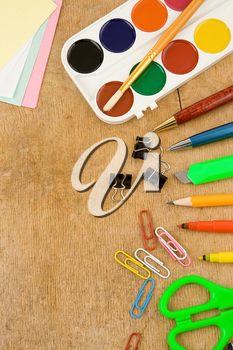 school accessories on wooden table