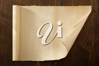 parchment scroll on wooden background