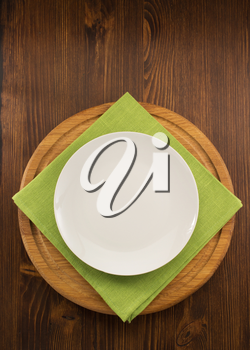 plate, knife and fork  on wooden background