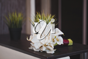 Beautiful bouquet from white flowers on a table.