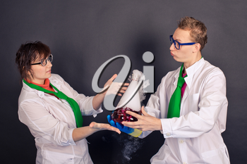 Creative scientists make experiments with liquid ice.
