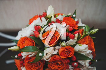 Orange bouquet from the flowers interwoven into it.