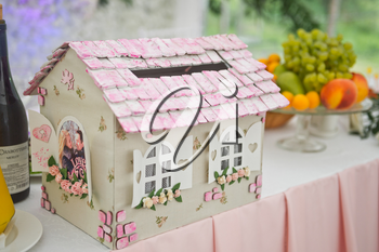 Gift box in the style of a small house.