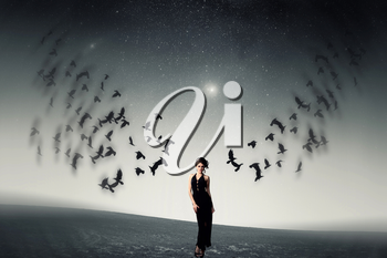 girl and a flock of crows. Elements of this image furnished by NASA