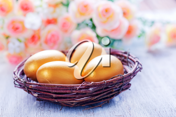 decorative painted Easter eggs on a table, easter background