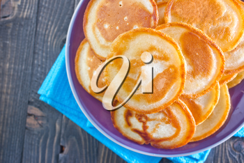 pancakes on the  plate and on a table