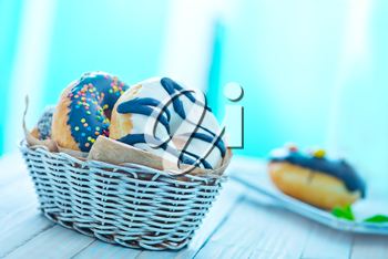 sweet donuts in basket and on a table