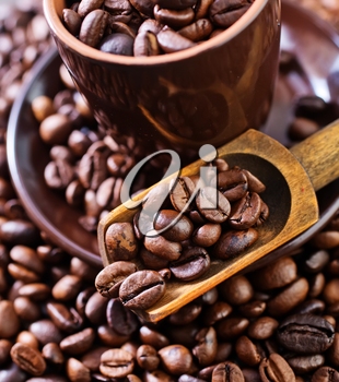 coffee beans on the wooden table, roast coffee beans