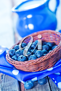blueberry in basket and on a table