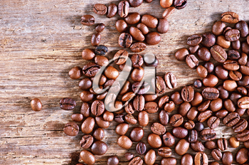 dry coffee beans on the wooden table