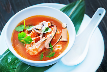 fresh asian soup in bowl and on a table