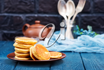 fresh pancakes on plate and on a table