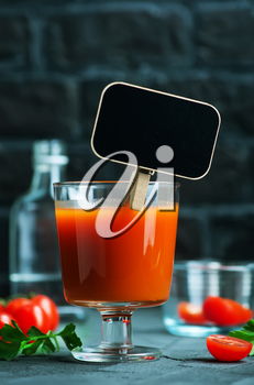 Cocktail Bloody-Mary in glass and on a table