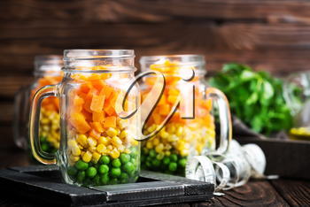 fresh salad with corn and green peas in bank