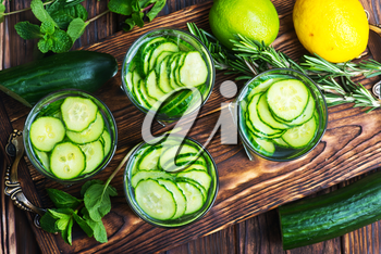 fresh cucumber drink with lemon on the wooden tray