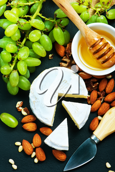 cheese with honey and nuts on a table