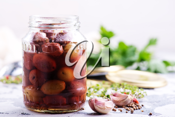 olives in bank and on a table