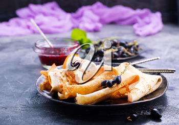 pancakes with berries on plate, stock photo