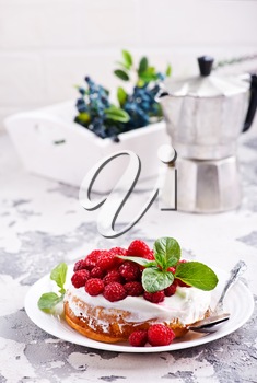 cake with raspberry and cream on a table