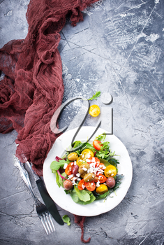 salad on plate and on a table