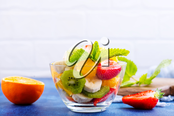 fruit salad in glass bowl and  on a table