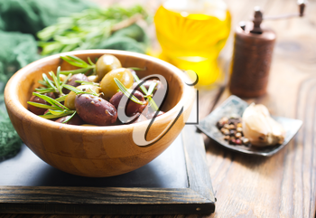 olives im bowl and oil, stock photo