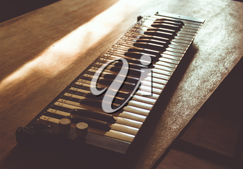 Vintage lonely sad keys on a wooden table