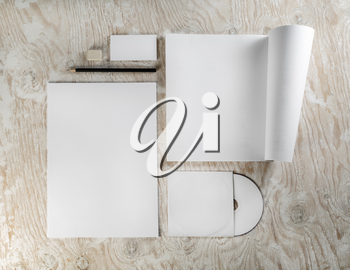 Branding identity set on light wooden background. Template for design presentations and portfolios. Top view.