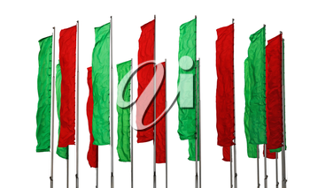 Several flagpoles with vertical green and red flags
