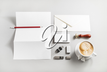 Photo of blank stationery set on paper background. Corporate identity template. Responsive design mockup. Top view.