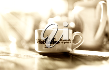 Morning sepia coffee with light leak bokeh background
