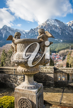 Cantacuzino Castle and the Carpathian Mountains in a sunny day. Residence and museum in a Transylvanian Busteni city, Romania