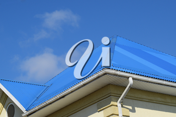 Blue roof metal sheets. Modern types of roofing materials.